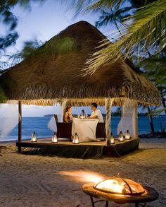 Dining at the Hilton Bora Bora Nui's private islet, Motu Tapu, for a true island experience.