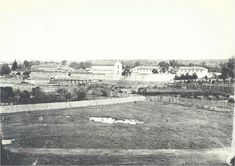 """Parramatta Asylum precinct in 1878,from corner O'Connell and Dunlop Streets.At the left is Gov. Gipps' Prison cell block demolished in 1886.The three storied building was the Ward for the Criminally Insane,built in stages from 1864-69 and demolished in 1963.Behind it (obscured) is the Female Factory main barracks demolished 1884.The long one at the right. Known as the """"Spinal Range"""" it was constructed in 1876."""