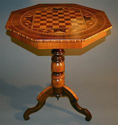 Italian Antique Inlayed Chessboard Table $1,900 Description: This is a fabulous design -- with an excellent classic inlaid chess motif. A very rare and  important Italian table, it makes a statement. Hand-made by an Italian artisan, circa 1910 - 1930, it is a high quality, heavy table, solidly constructed, refinished to perfection. Every intricate detail, from top to foot, shows beautifully.