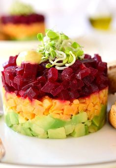 Beets and sweet potatoes come together in a simple dressing to make this vegan-friendly beet and sweet potato tartare. Serve as an appetizer or main dish. Beet Recipes Healthy, Raw Food Recipes, Veggie Recipes, Vegetarian Recipes, Cooking Recipes, Tartare Recipe, Timbale Recipe, Vegetable Seasoning, Vegan Appetizers