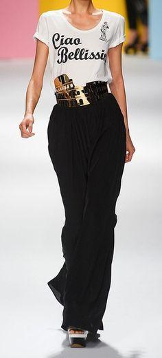 Janae's style--White graphic tee with Rome gold foil detail, black slacks.