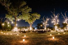 This image was in my head from the second we started planning the wedding. Not far from where this photo was taken, Ryan proposed one year earlier in a similarly glowing setting. I really wanted to capture that same lantern-lit magic of a fireside braai (South African barbecue) beneath the stars and surrounded by wildlife. Rangers drove guests directly from their game drive to this remote dinner location . . . no one had a chance to change clothes, but when the Land Rovers pulled up to this…