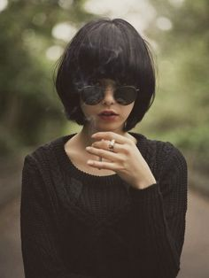 Sweater, sunnies, cigarettes + the best hair.
