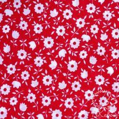 coton fleuri sur fond rouge