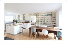 White kitchen interior with rustic wooden table