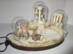 One of the most charming miniature #Nativity sets ever made. #Olszewski #Goebel handpainte bronze miniatures on resin bases, lighted with glass domes. #LimitedEdition of only 5000 from 1991, hard to find complete set.
