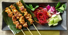 Satay is probably Malaysia's most famous contribution to the culinary world. It consists of small pieces of marinated meat (usually chicken) skewered on sticks and grilled over a charcoal fire. The skewers are then brushed with oil mixed with honey and spices and served with a spicy peanut dip. ^jn