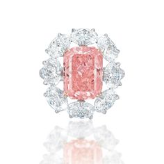 GIA Grading Results: 5.18 ct, natural color Fancy Vivid pink, VS2 clarity (GIA report 2165887854). The additional oval brilliants have GIA reports that state they weigh between 0.50 ct and 0.59 ct, are E to F color and Internally Flawless to VS1 clarity.