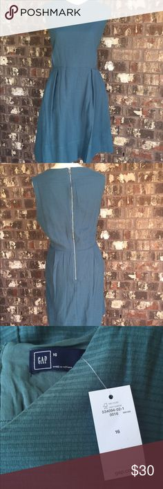 """Gap teal ribbed dress, size 16 New with tags! Beautiful blue-green color, lined at the bottom and comfortable! Zip back and very figure flattering! See photo for material. Measurements (flat): bust: 21.5"""" (armpit to armpit), waist: 18.5"""", length: (top to bottom) 37.5""""' (top of waist to bottom) 20.5"""". All measurements are to the best estimate. GAP Dresses"""