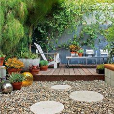 Side Yard Idea. stone path. i like the raised wooden floor idea for small area seating