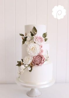 Soft pinks and greens in the florals on this elegant wedding cake are just perfect! #weddingcakes