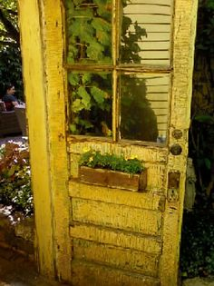 The Wells St Art Fair in Chicago has a garden walk, too. This is a door leading into a beautiful small garden.