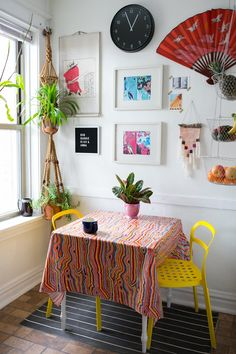 The table, hanging planter and much of the artwork were thrifted. The yellow chairs are from IKEA.