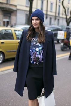 Black skirt with print t-shirt, dark blue coat and blue wool hat. #coat #skirt