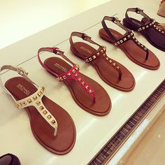 Michael Kors thong sandals.
