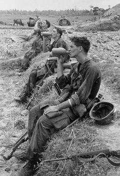 Soldiers of the 25th Infantry Division drink from their canteens during a break in their patrol operations in Duc Pho, Vietnam. Aug. 31, 1967.