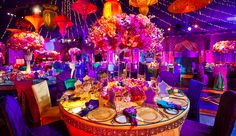 An actual Aladdin-themed reception!  Have you ever seen anything more gorgeous?! (Note the Genie on the far left wall)