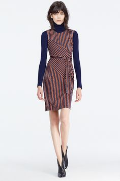 This fresh sleeveless faux wrap dress was made for layering. In a vibrant rickrack print, it can stand alone in summer or be worn under or over a slim turtleneck come fall.
