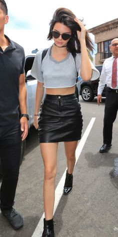 Kendall Jenner makes leather work for warm weather by balancing a judicious use of the heavy material with lightweight knitwear and lots of skin. The model's signature accessories—dark sunglasses and a thin choker—complete the ensemble.