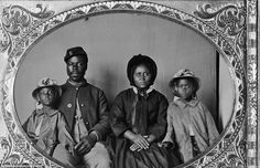 On the road to freedom: An African American soldier in Union uniform with wife and daughters between 1863 - the year of the Emancipation Proclamation - and 1865.  Image will appear in book Envisioning Emancipation in commemoration of the 150th anniversary of the Emancipation Proclamation which was issued on January 1, 1863.