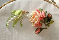 Tutorial: step by step pictures of lily of the valley with rose and rosebuds worked in ribbon embroidery                                                                                                                                                      More