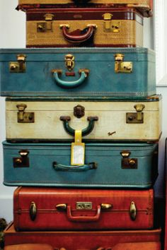 Vintage suitcases - you can find them in assorted colors and sizes.