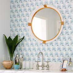 This is wallpaper, but it gives you an idea of what it would look like to put pattern above the sink.