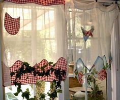 beautiful vintage aprons as curtains