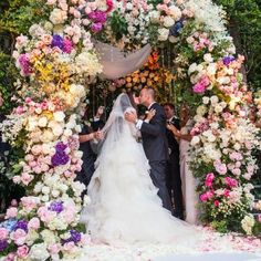 Does this colourful wedding arch inspire you? Is too much ever too much? For more inspiring ideas visit www.larrywalshe.com and follow @Larry Walshe Floral Design #flowers #wedding #church #arch