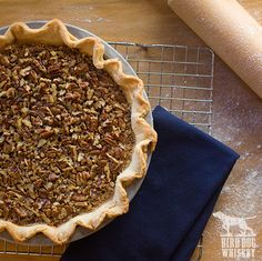 Bird Dog Peach Whiskey Pecan Pie  Makes 1 (9-inch) pie Make your pie the day before. Store it wrapped in plastic at room temperature. 1/2 (15-ounce) package refrigerated piecrust dough 1/2 cup sugar 1/2 cup light corn syrup 1/4 cup light brown sugar 1/4 cup butter, melted 4 eggs, lightly beaten 2 cups chopped pecans 3 tablespoons Bird Dog Peach Whiskey 1/2 teaspoon vanilla extract 1/4 teaspoon salt Peach Whiskey, Whiskey Recipes, Just Peachy, Dessert Recipes, Desserts, Corn Syrup, Fall Recipes, Sweet Tooth, Desert Recipes
