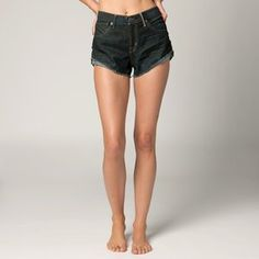 """FOX RACING PIN UP WOMENS SHORTS DIRTY RINSE WASH 7 by Fox Casuals. $48.60. High waisted short with cuffed outseam gives this style a dolphin look. Logo metal shank and rivets. Black Fox denim patch with hammered nail heads at back of waistband. 2"""" Inseam. Save 14%!"""