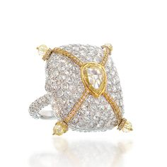 Lugano Diamonds,2 carat Pear shape, 9 carats rose cut diamonds 1.90 carats fancy yellow diamonds. open the locket and find a 18 K yellow gold book