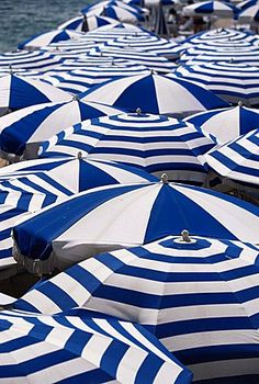 Blue and white beach umbrellas, Cannes, Alpes Maritimes, Provence, French Riviera, France, Europe