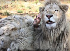 Kevin Richardson, a.k.a. the Lion Whisperer lays with two of his lions in their enclosure at the Kingdom of the White Lion Park in Broederstroom, near Johannesburg South Africa