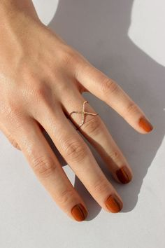 Reversible X-Ring can be worn with the X in front or flipped around as a double band. Available in Yellow Gold Fill, Rose Gold Fill + Sterling Silver. Handmade in Oakland, CA. Minimalist Nails, Nagel Gel, Beautiful Nail Designs, Nail Decorations, Nail Polish Colors, Toe Rings, Halloween Nails, Toe Nails, Nails Inspiration