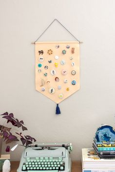 Your pin collection can double as wall art when you make this DIY pin storage banner. Wall Banner, Diy Banner, Cheap Wall Art, Diy Wall Art, Wall Decor, Pin Collection Displays, Display Banners, Party Banners, Diy Store