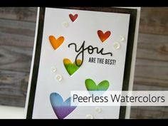 Peerless Watercolors + Lawn Fawn Die Cutting. Love the rainbow colors peeking through the heart die cut openings.