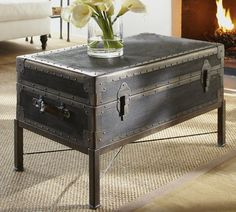 Ludlow Trunk Coffee Table | Pottery Barn - tons of storage in this guy!  i like the patina'ed finish $699