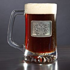 Perfect for groomsmen, colleagues, or any beer drinking friend, our custom beer mug is sure to become a favorite drinking glass. Made of glass, this custom beer mug comes with an embossed pewter crest...