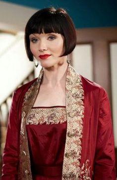 miss fisher. red silk ensemble.