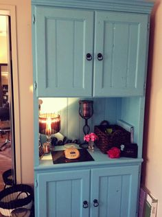 Refurbished hutch as a color bar! Cute idea for color storage and an area for mixing