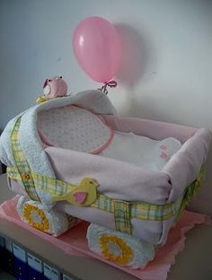 diaper cake making this for Brittany!!! Eeekkkkkk :)