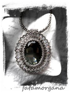 Swarovski oval cabochon beaded whit Miyuki delicas and Czech crystals (2012). Giuliana Verdelli Design.
