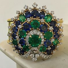 Spectacular bangle forming clip brooch by Bulgari. From La Dolce Vita jewels, part of our Magnificent Jewels auction, Geneva 17 May.   @christiesjewels @christiesinc #christiesjewels #christiesinc #christies @bulgariofficial  #emerald #sapphire #diamond #bangle #clipbrooch #geneva