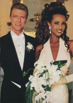 David Bowie and ImanWith his Thin White Duke days behind him, David Bowie went full-on traditional for his 1991 Swiss wedding to supermodel Iman. She wore classic white, flowing tresses, and arm-length gloves, while he looks like the groom figurine on top of the wedding cake in his black tux.
