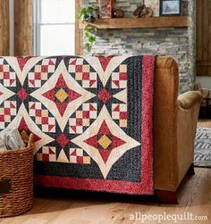 Time to Shine by Tiffany Hayes of Needle in a Hayes Stack. Fabrics: Pearl Essence Scrolls collection by Maywood Studio. Contrasting star blocks give a quilt vitality and amped-up interest.