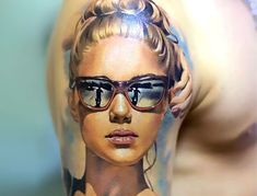 A really amazing portrait of a beautiful lady in sunglasses. This piece can adorn the shoulder of any man.