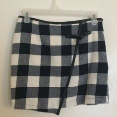 San Scouci Check Mini Skirt Versatile navy and white checkered skirt- great for holidays, winter months, or throughout the seasons with its cute preppy vibe. This brand is carried by UO grab for a steal today! Price is firm. T.V.- $25 size is a S, fits like an Xs; perfect for a 00. Urban Outfitters Skirts Mini