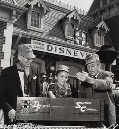 • Hawaii's own eight-year-old Raymond Sleeper became the 10-millionth Disneyland Railroad passenger in August, 1960. He took this historic ride with Walt Disney himself, as well as R.G. Rydin, Atchison, Topeka, & Santa Fe Executive Vice President.Walt is seen here sifting through the 10,000 pennies in a presentation boxcar that Raymond was awarded.