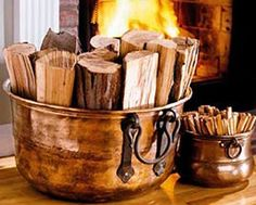 Firewood in Copper.love the shiny copper next to a flickering fire. Wood Storage Box, Firewood Storage, Firewood Holder, Storage Ideas, Estilo Country, Copper Pots, Copper Planters, Copper Kitchen, Metal Containers